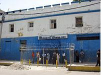 Outside the Haitian National Penitentiary in downtown Port-au-Prince; almost none of the men inside have been convicted of a crime.          Click image to expand.
