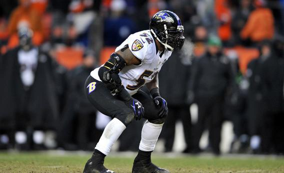 Forced to wear a brace after tearing his triceps, Ray Lewis of the Baltimore Ravens lines up on defense