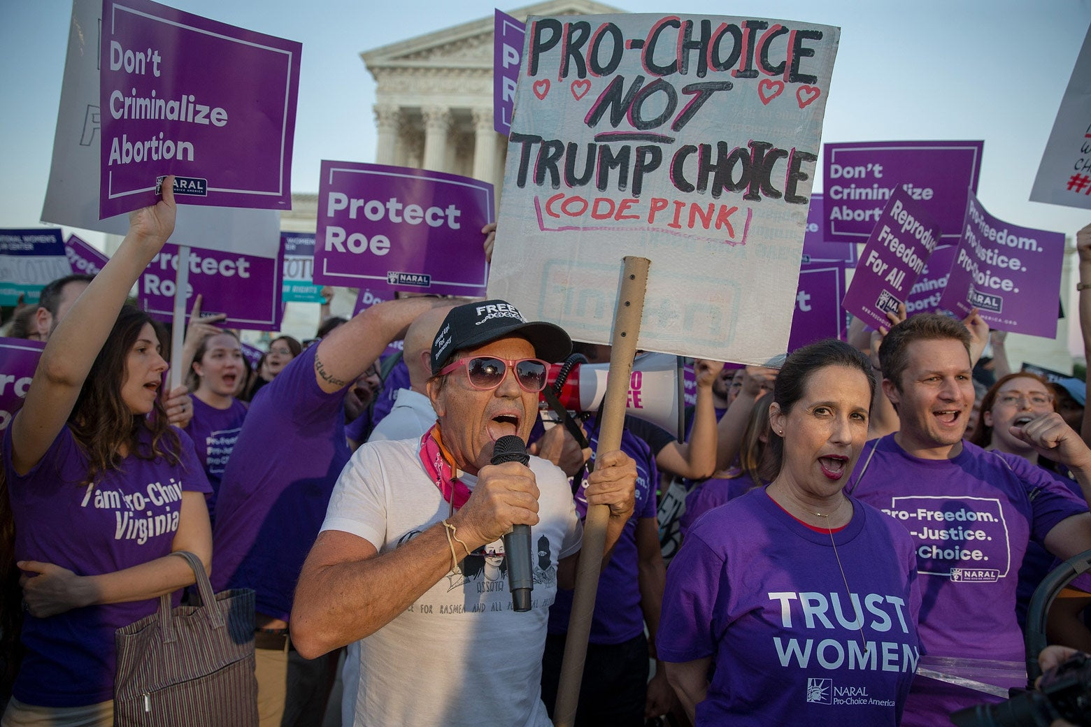 Pro-choice and anti-abortion protesters demonstrate in front of the U.S. Supreme Court on July 9 in Washington.