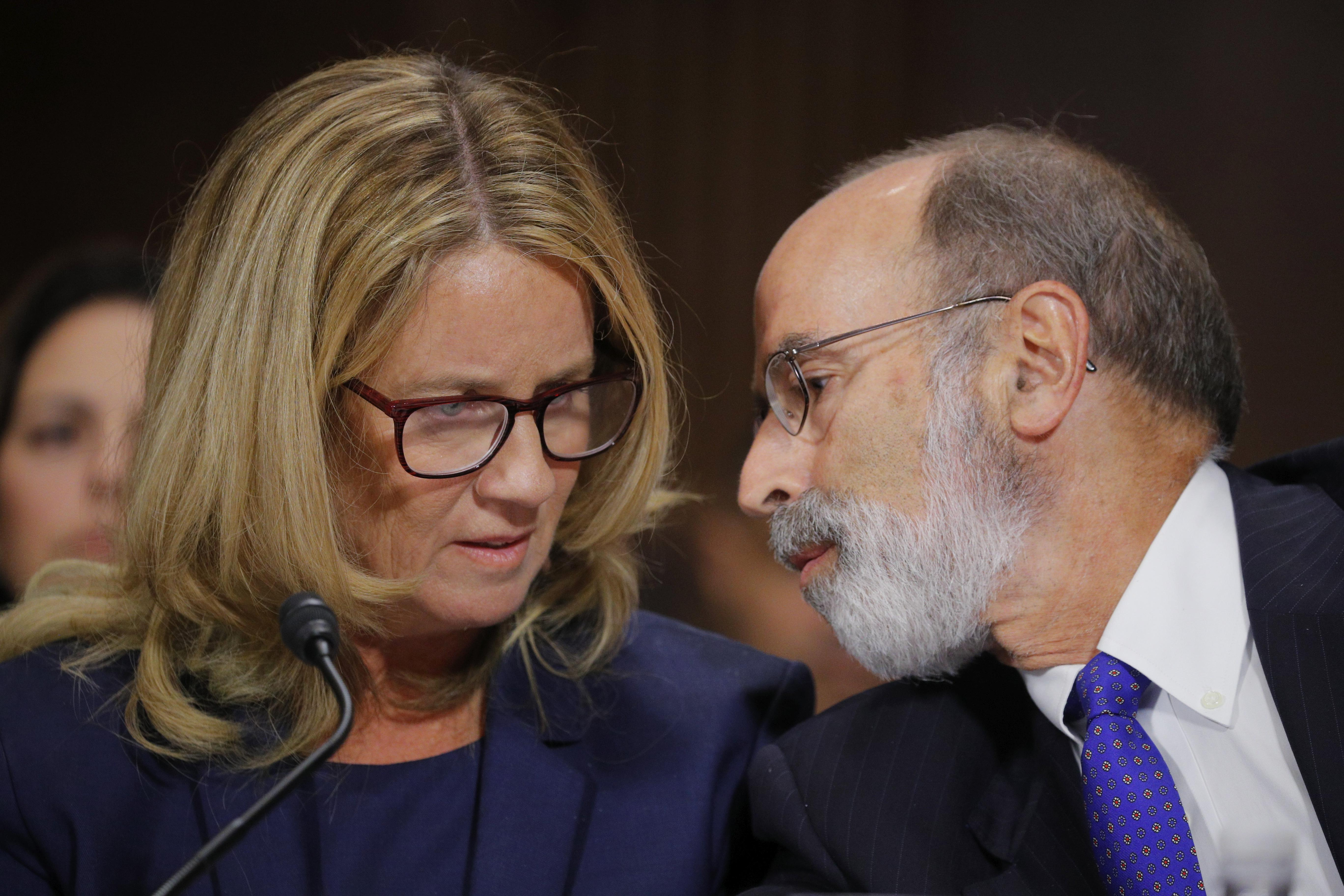 Christine Blasey Ford confers with Michael Bromwich at the hearing.