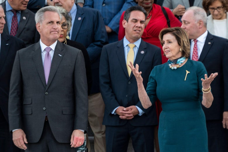 Speaker of the House Nancy Pelosi speaks with Rep. Kevin McCarthy (left) before a moment of silence by congressional leaders to honor the 600,000 American lives lost to COVID-19 at the U.S. Capitol in Washington, D.C. on June 14, 2021.