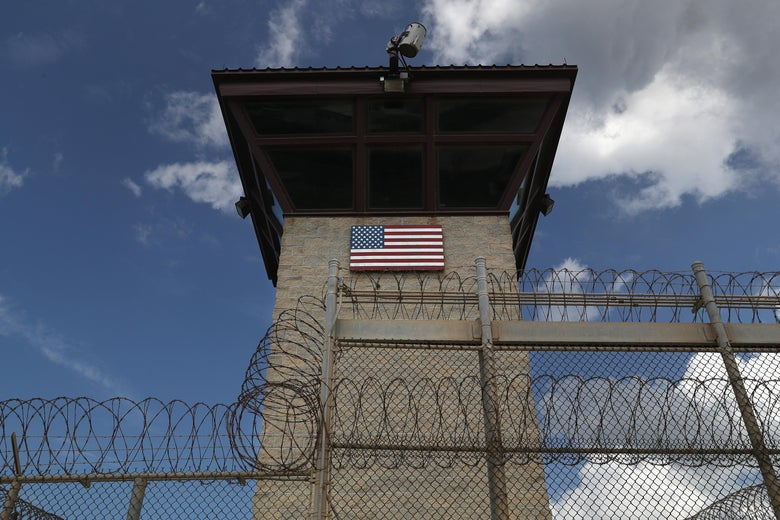 GUANTANAMO BAY, CUBA - OCTOBER 23: (EDITORS NOTE: Image has been reviewed by the U.S. Military prior to transmission.) A guard tower stands at the entrance of the U.S. prison at Guantanamo Bay, also known as 'Gitmo' on October 23, 2016 at the U.S. Naval Station at Guantanamo Bay, Cuba. The U.S. military's Joint Task Force Guantanamo is still holding 60 detainees at the prison, down from a previous total of 780. In 2008 President Obama issued an executive order to close the prison, which has failed because of political opposition in the U.S.  (Photo by John Moore/Getty Images)