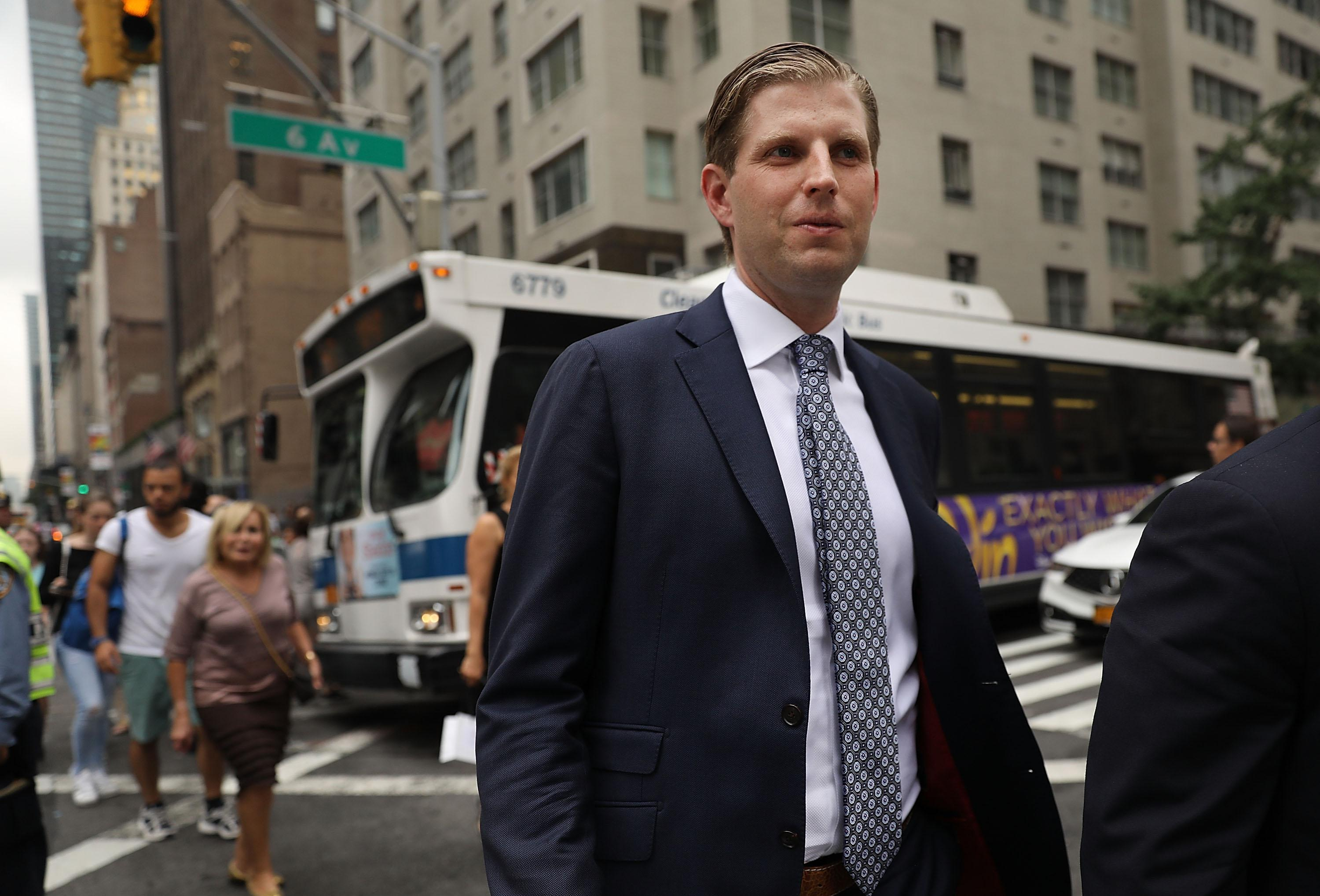 Eric Trump, son of President Donald Trump, walks outside of Trump Tower on August 15, 2017 in New York City. Security throughout the area is high as President Trump arrived at his residence in the tower last night, his first visit back to his apartment since his inauguration.