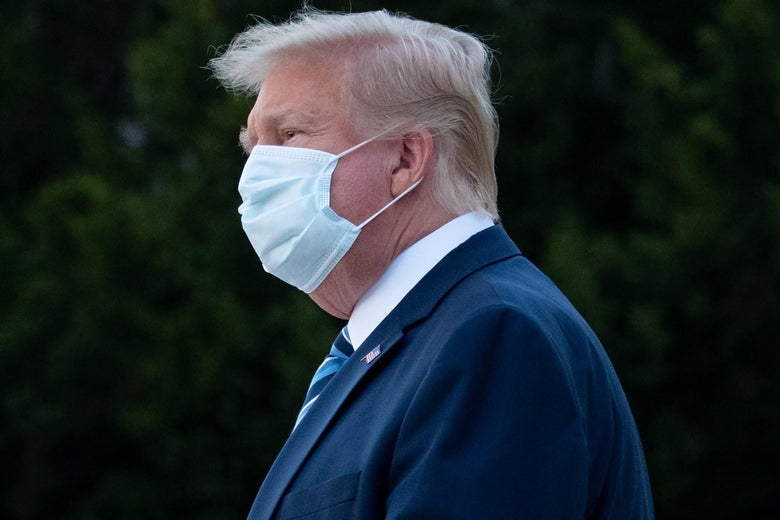 Trump wears a face mask as he leaves Walter Reed Medical Center after being hospitalized in October.