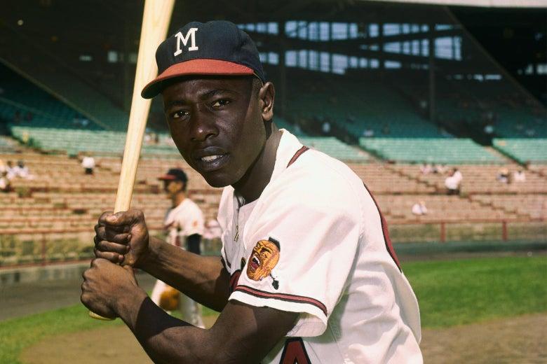 Hank Aaron in a batting pose, wearing a Milwaukee Braves uniform.