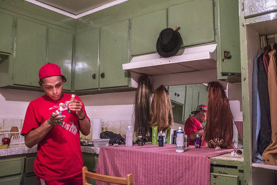 Sex worker Oscar Villareal, 28, in his kitchen in Tijuana, Baja California, Mexico, July 20, 2014.