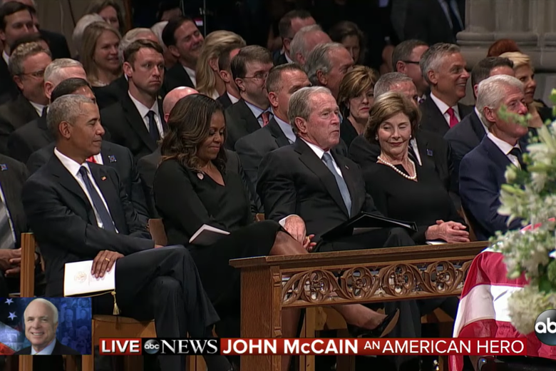 Video Shows George W. Bush Slipping Candy to Michelle Obama at McCain's Funeral