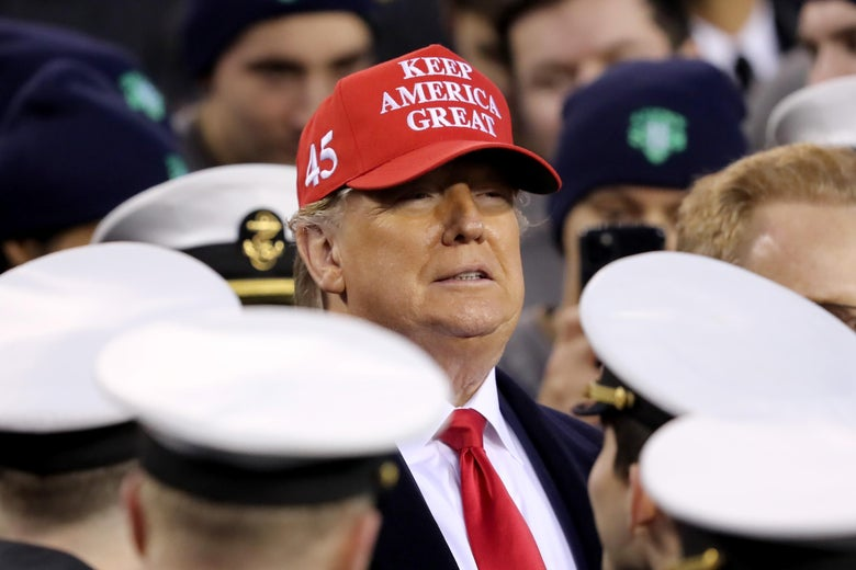 President Donald Trump stands with the Navy side of the field to start the second half of the game between the Army Black Knights and the Navy Midshipmen at Lincoln Financial Field on December 14, 2019 in Philadelphia, Pennsylvania.