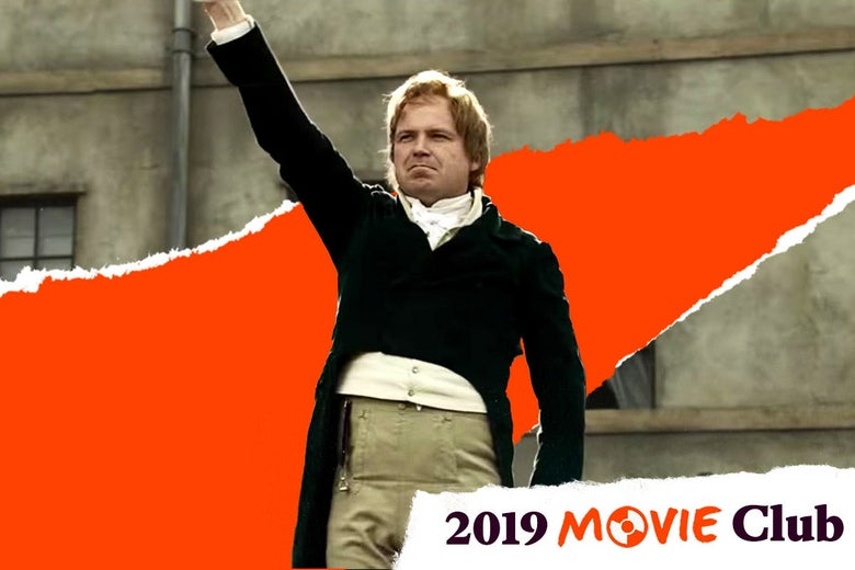 "Rory Kinnear raises his fist while wearing period clothes in Peterloo. Text in the corner says, ""2019 Movie Club."""