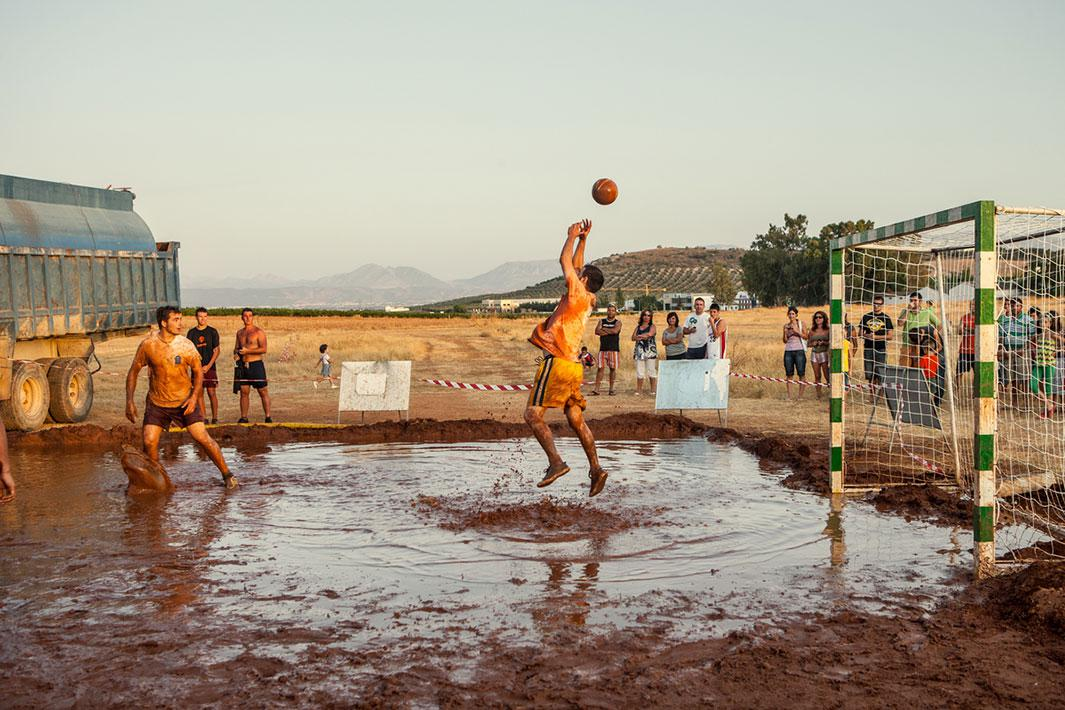 MOLLINA, SPAIN - AUGUST 12 2009: Young men play mud-football. The budget for patronal festivities has been cut so much that only very cheap activities were possible. Photo by Carlos Spottorno / Getty Images