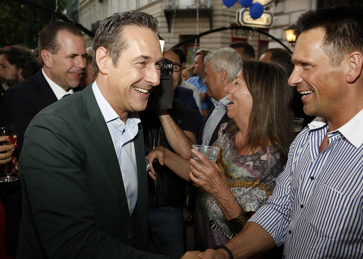 Heinz-Christian Strache (left), leader of the right-wing Austrian Freedom Party, celebrates with supporters after European Parliament elections on May 25, 2014, in Vienna.