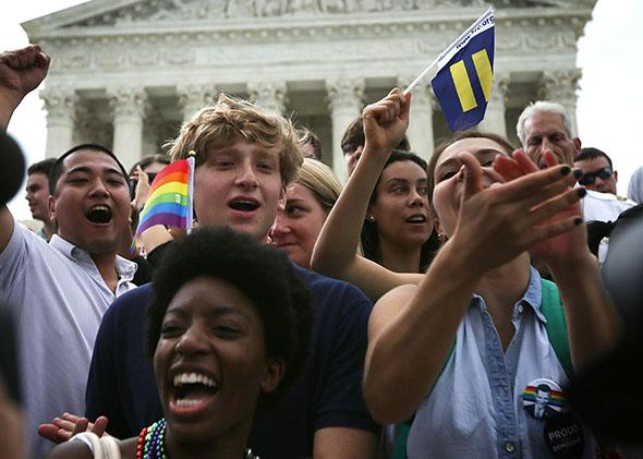 Same-sex marriage supporters rejoice after the U.S Supreme Court hands down a ruling regarding same-sex marriage June 26, 2015 outside the Supreme Court in Washington, DC.