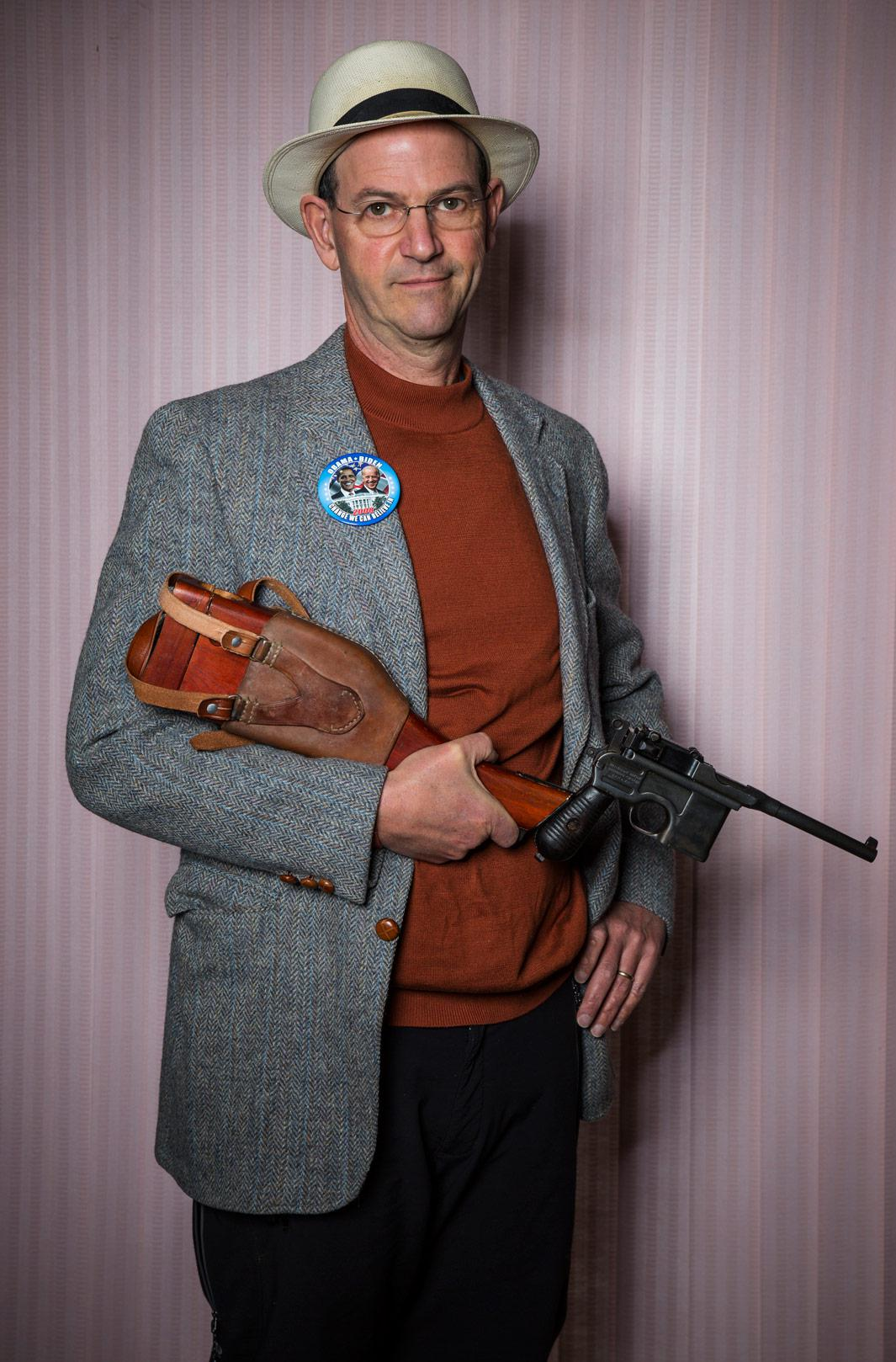 Writer Dan Baum holds his beloved 7.63-mm Mauser C96, made in 1896, at his home on Feb. 24, 2013, in Boulder, Colo.