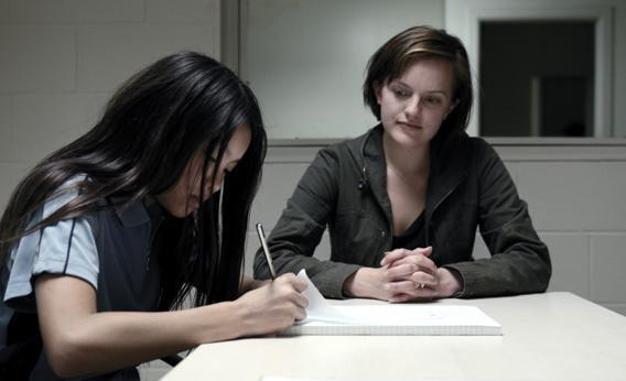 (L) Michelle Ang as Kimmie and (C) Elisabeth Moss as Robin Griffin.