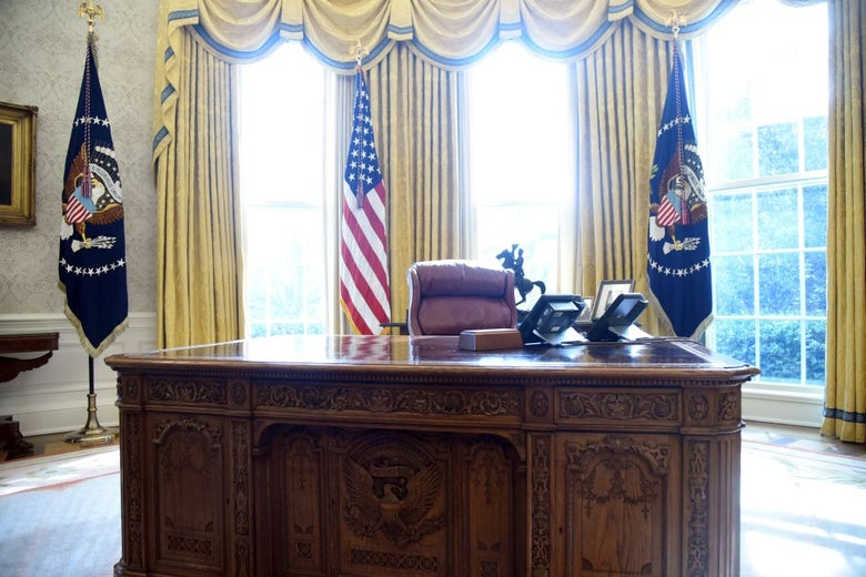 The president's desk sits empty in the Oval Office.
