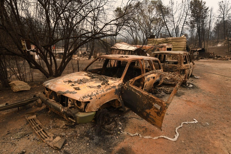 Burnt cars sit ruined in the Keswick neighborhood of Redding, as the Carr fire continues to spreads towards the town of Douglas City near Redding, California on July 31, 2018.