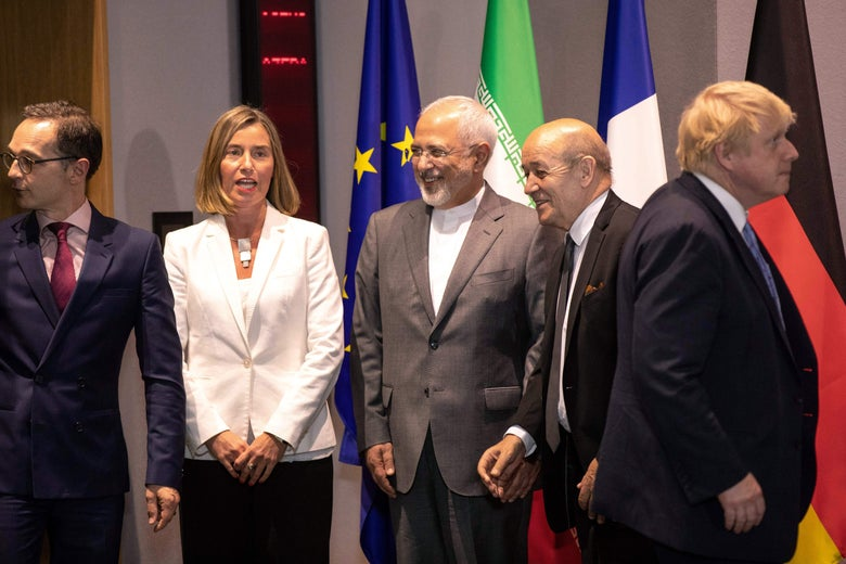 Iran's Foreign Minister Mohammad Javad Zarif (C), Britain's Foreign Secretary Boris Johnson (R), France's Foreign Minister Jean-Yves Le Drian (2nd R), Germany Foreign Minister Heiko Maas (L) -- the ministers of the three European signatories to the 2015 nuclear deal - and EU High Representative for Foreign Affairs Federica Mogherini (2nd L) pose before a meeting of EU/E3 with Iran at the EU headquarters in Brussels on May 15, 2018. - Iran's foreign minister said on May 15 that efforts to save the nuclear deal after the abrupt US withdrawal were 'on the right track' as he began talks with European powers in Brussels. (Photo by Olivier Matthys / POOL / AFP)        (Photo credit should read OLIVIER MATTHYS/AFP/Getty Images)