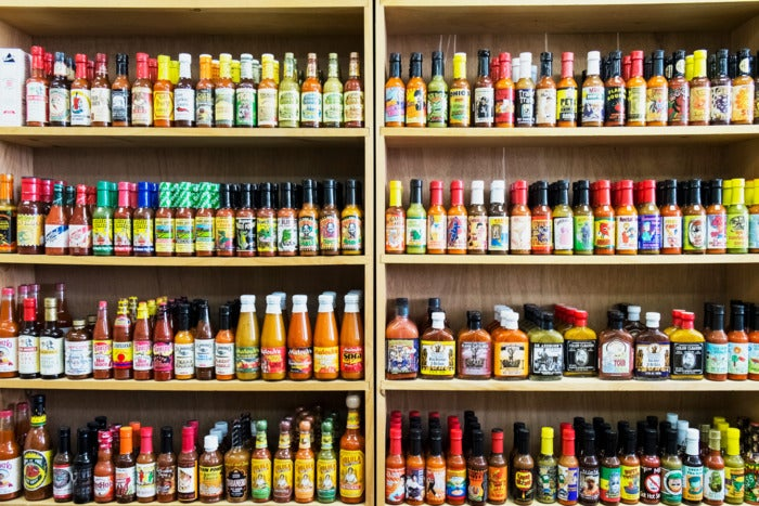 Hot sauces on shelves.
