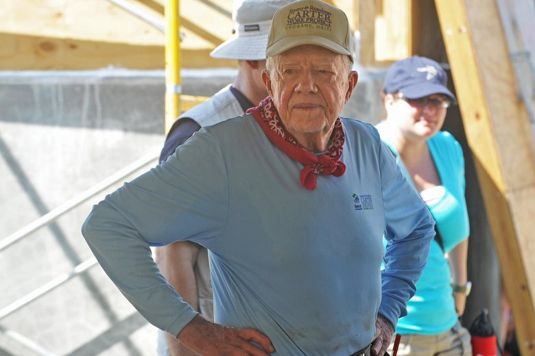 Former president Jimmy Carter helps build a house for victims of the Jan. 2010 earthquake in Haiti.