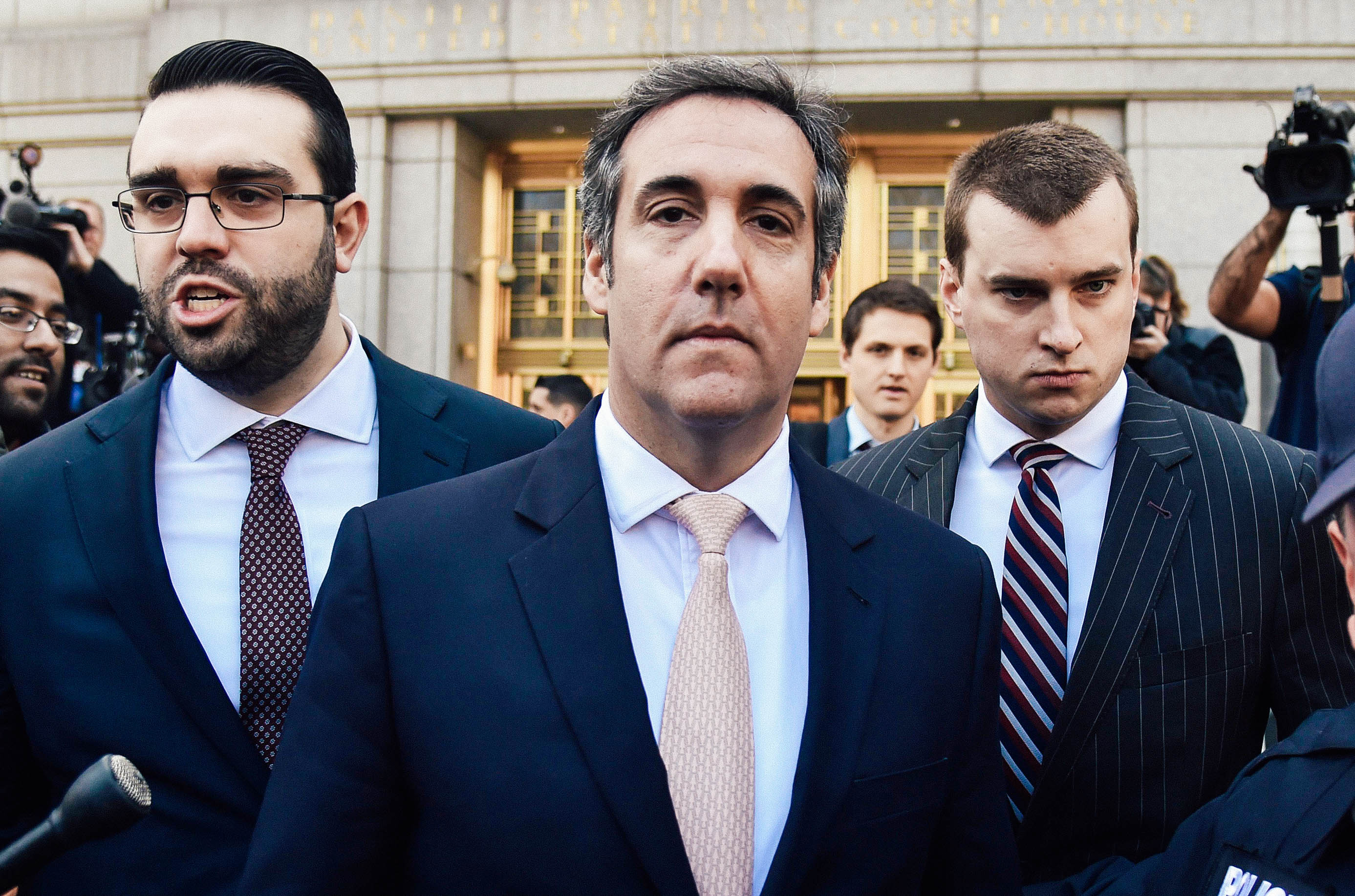 Michael Cohen leaves the U.S. Courthouse in New York, surrounded by police, his lawyers, and journalists.