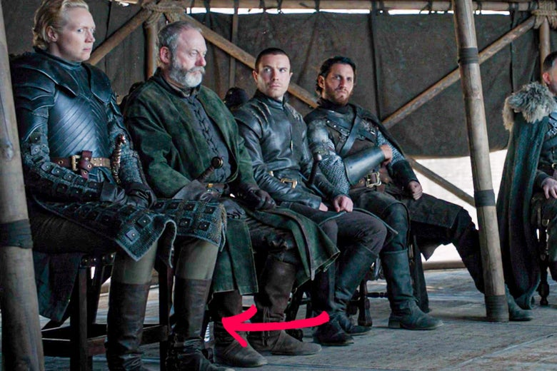 Actors in Game of Thrones' finale with a plastic water bottle visible at their feet.
