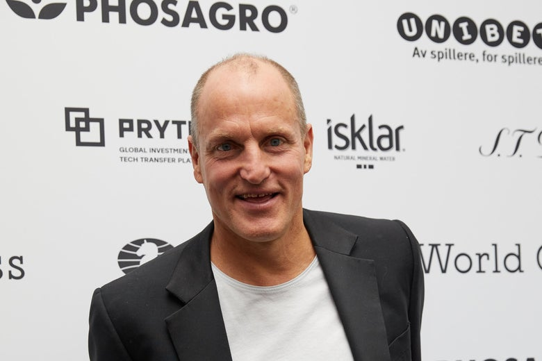 Woody Harrelson attends smiles, wearing a white shirt and black suit.