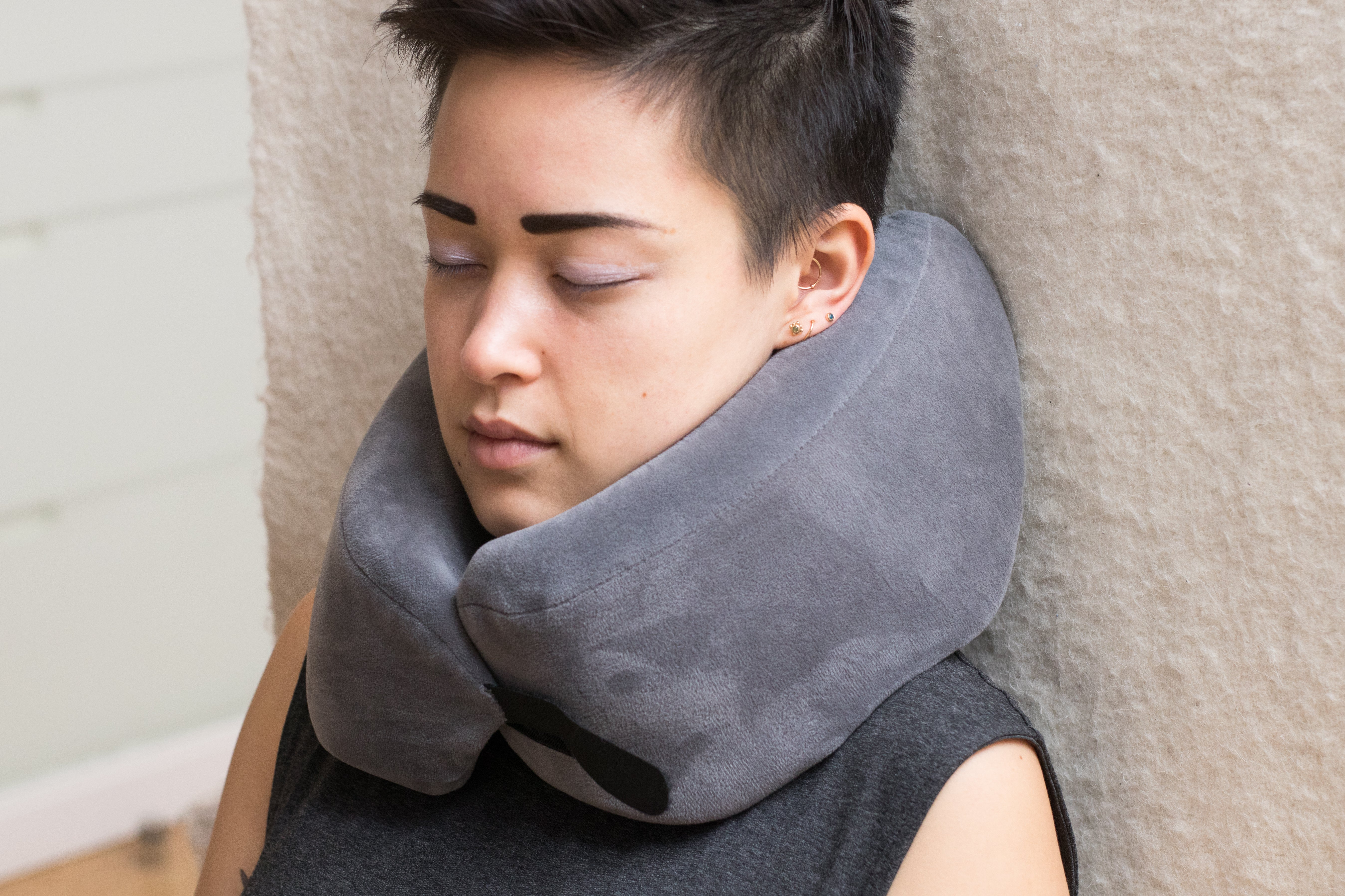 Woman wearing the Travelrest Ultimate Memory Foam Travel Pillow.