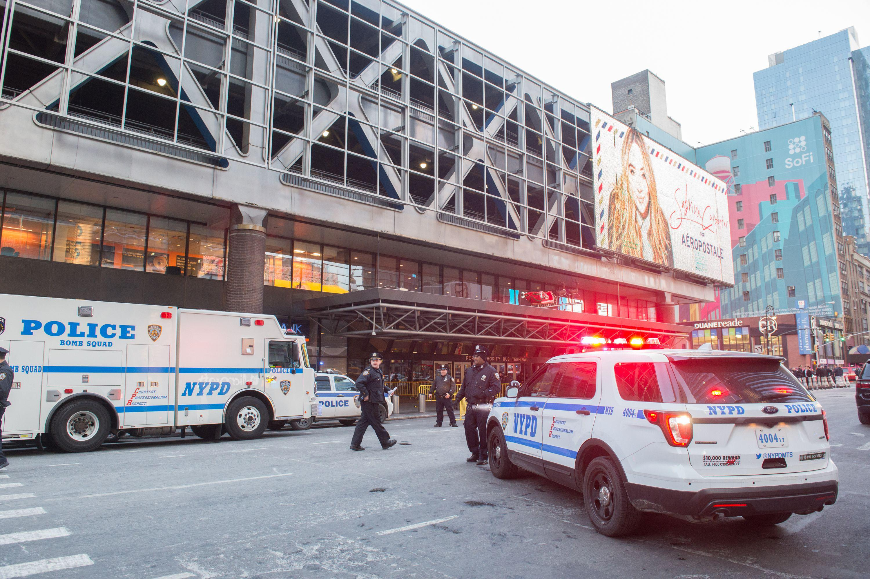Police and other first responders respond to a reported explosion at the Port Authority Bus Terminal on December 11, 2017 in New York.         New York police said Monday that they were investigating an explosion of 'unknown origin' in busy downtown Manhattan, and that people were being evacuated. Media reports said at least one person had been detained after the blast near the Port Authority transit terminal, close to Times Square.Early media reports said the blast came from a pipe bomb, and that several people were injured.          / AFP PHOTO / Bryan R. Smith        (Photo credit should read BRYAN R. SMITH/AFP/Getty Images)