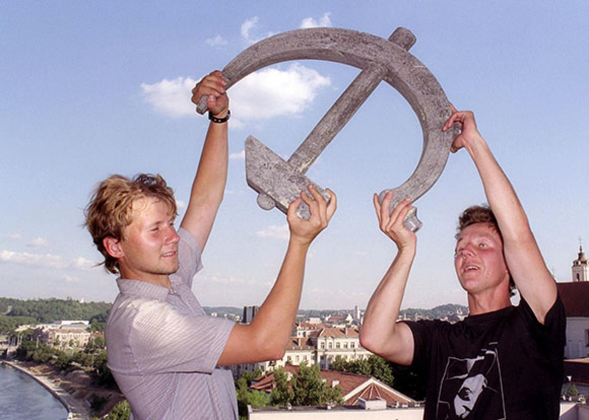 Two young Lithuanians display a hammer and sickle.