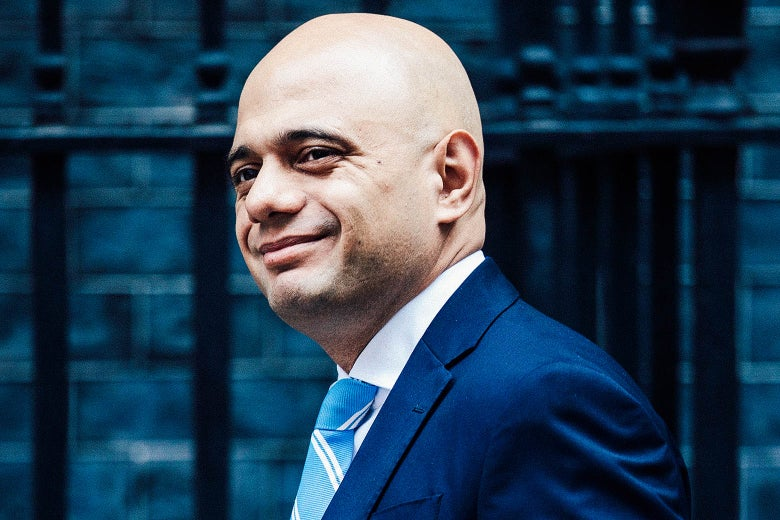 Sajid Javid smiles in front of 10 Downing Street.