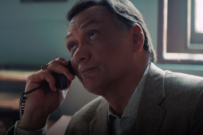 Jimmy Smits, on hold, looking bored