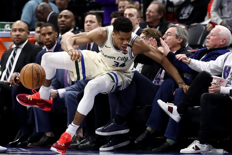 Giannis Antetokounmpo falls into the crowd during a game in January in Sacramento.