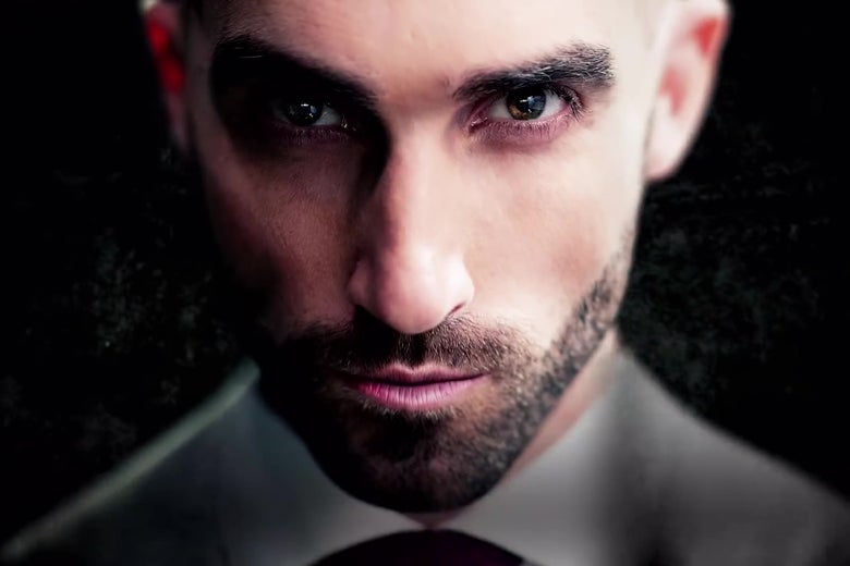 Magician Drummond Money-Coutts, in an extreme close-up, staring intently.