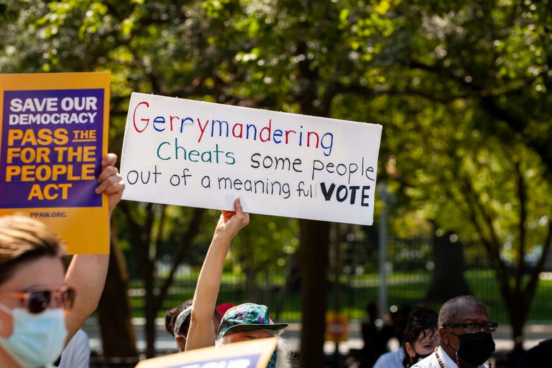 A protester holds a sign opposing gerrymandering.