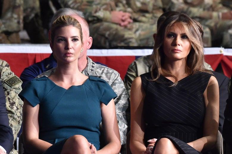 Ivanka Trump and Melania Trump seated side by side.