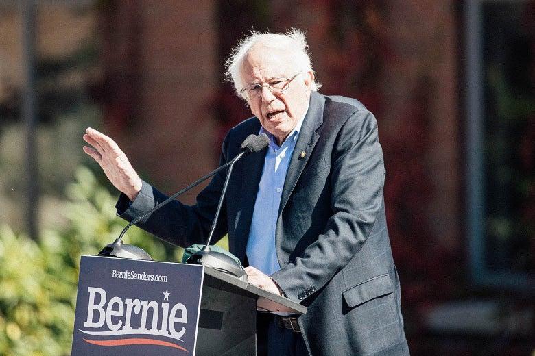Sanders speaking at a podium.