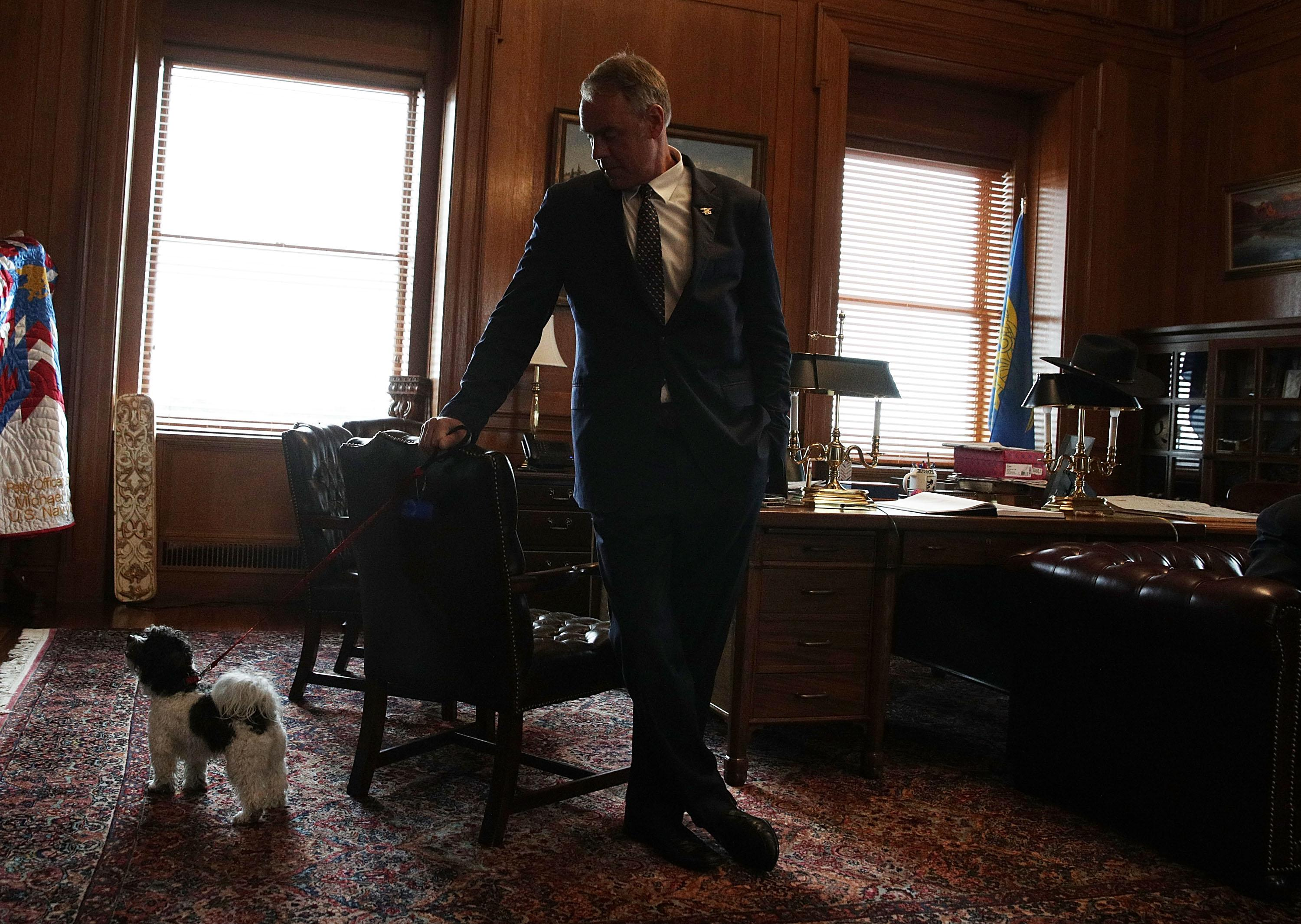 Interior Secretary Ryan Zinke and his dog in his office for a Take Your Dog to Work Day event on May 5, 2017 at the Interior Department in Washington, DC.