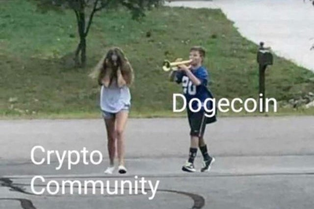 """Meme of a boy labeled """"Dogecoin"""" blasting his trumpet at a girl labeled """"Crypto Community"""" covering her ears"""