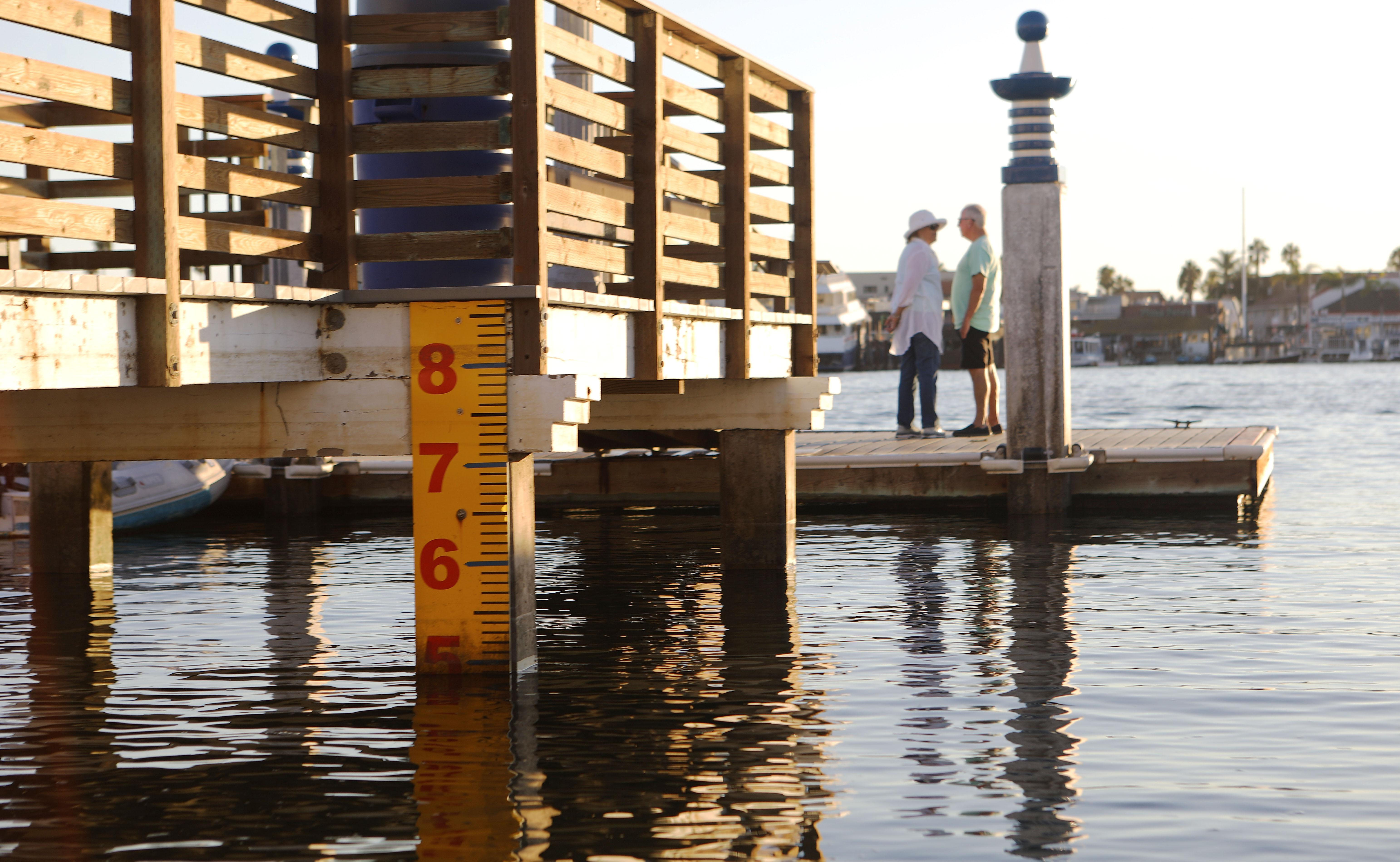 A water-level marker is attached to a California dock.