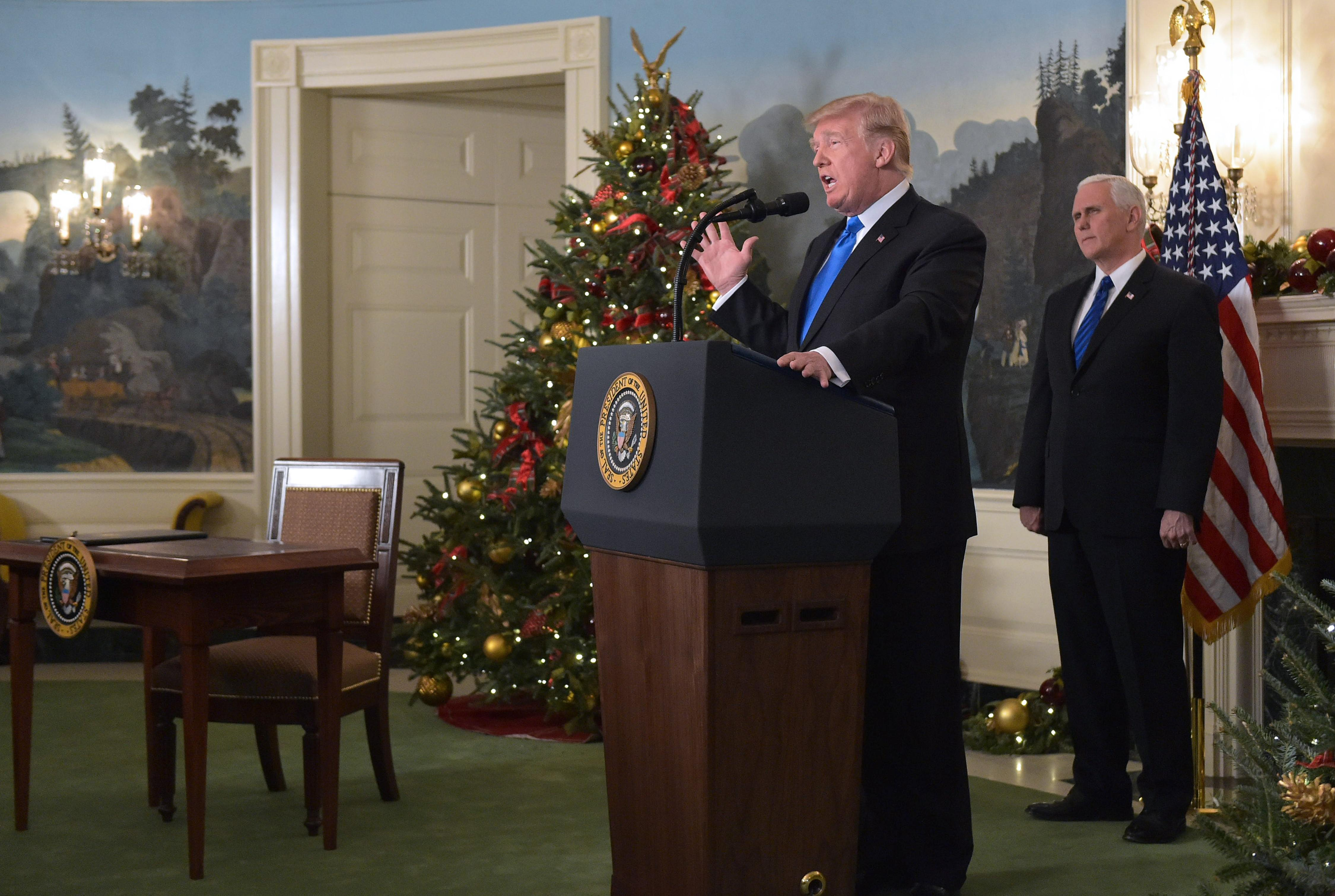 US President Donald Trump delivers a statement on Jerusalem from the Diplomatic Reception Room of the White House in Washington, DC on December 6, 2017 as US Vice President Mike Pence looks on.  / AFP PHOTO / MANDEL NGAN        (Photo credit should read MANDEL NGAN/AFP/Getty Images)