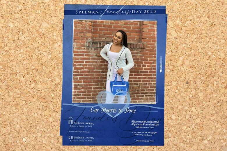 Olivia in Spelman gear, posing in front of a brick wall.