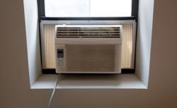 Air conditioner unit in window.