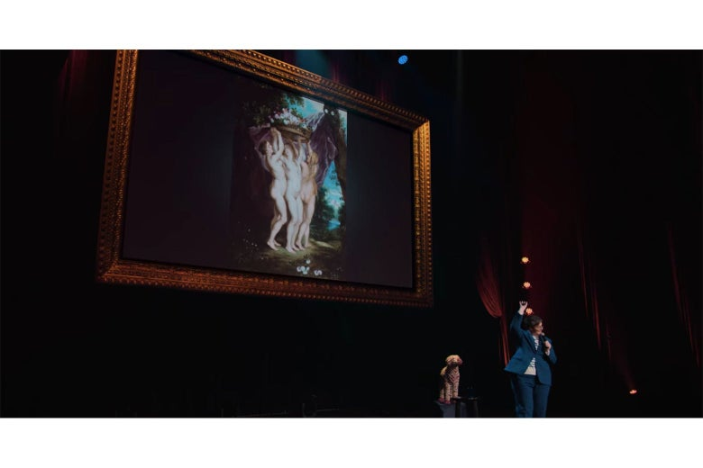 Hannah Gadsby stands in front of yet another painting of three naked women.
