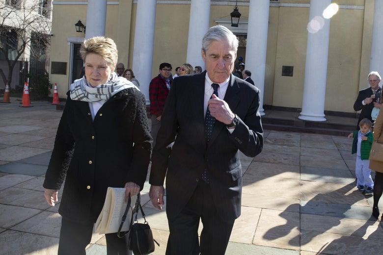 Robert Mueller walks with his wife, Ann.