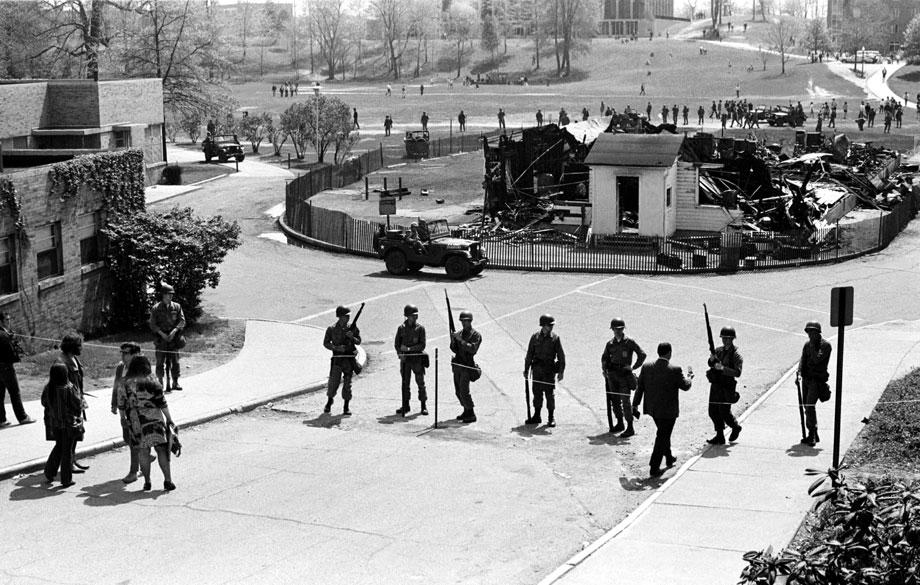 Guardsmen surround the charred remains of the Army ROTC building, May 4, 1970.