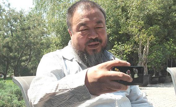 Ai Weiwei taking an iPhone photo.