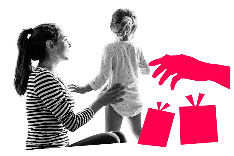 Woman holds a child while an illustrated hand reaches out over a couple of illustrated presents.