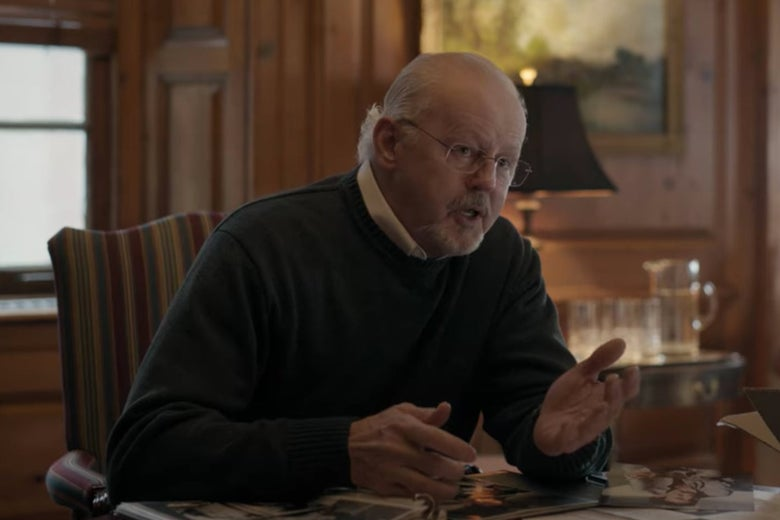 The dean of Pembroke sits at a desk.