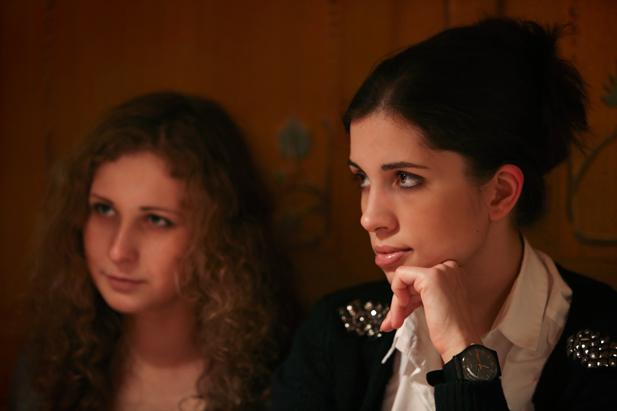 Pussy Riot's Nadezhda Tolokonnikova (R) and Mariya Alekhina in a cafe in downtown Moscow, January 3, 2014.