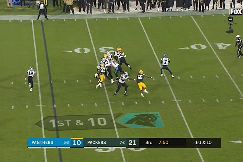 Televised football with giant arrow shown on the field